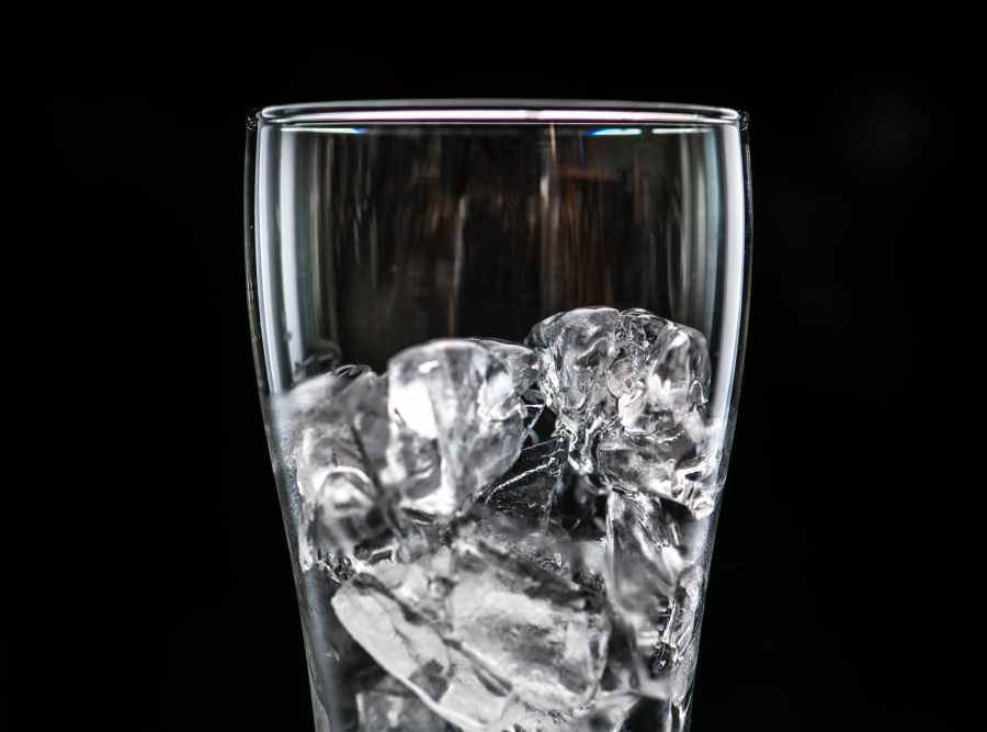 close up photo of clear drinking glass filled with ice